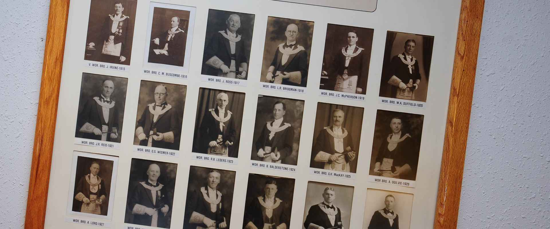 a photograph of a large picture frame with the earliest Masters of the Lodge from 1915-1932