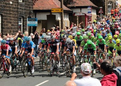 The Peloton passing the Church