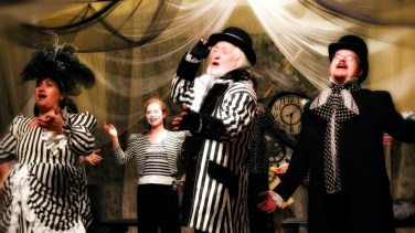 Angela Conzone Dwyer as Mrs. Zizzlebot, Meghan Gardner as Topsy Turvey, Richard O'Donnell as Belvedere Brumbleton, and Christopher Dwyer as Mr. Zizzlebot in Brazillia R. Kreep's Alice Isn't All There'
