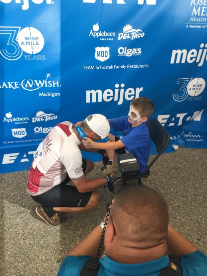 Team Joe's rode in honor of Wish Child Jaxon. He placed medals around Rob's neck and every rider of our team.