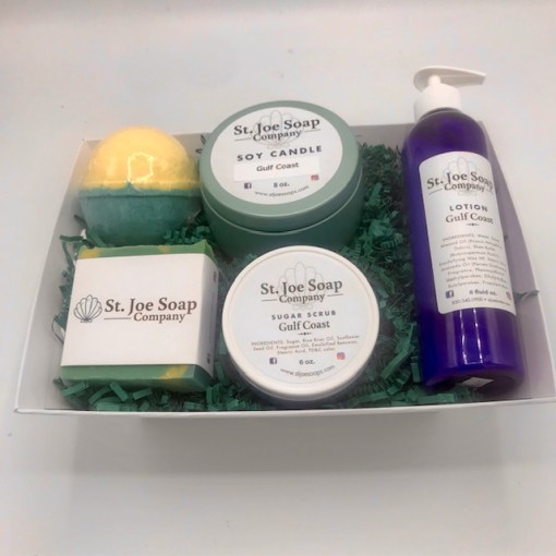 image of Gulf Coast Gift Basket with assorted soaps, candles, sugar scrub and lotion, and bath bomb