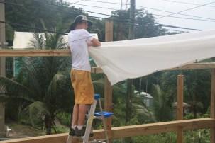 Mathew Gibney installing the Muslin