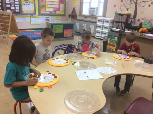 1st grade math learning activity in classroom