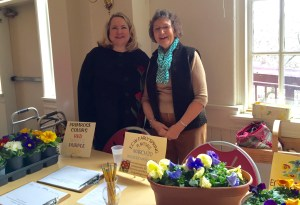 Leslie Tahsler and Sue Martin are ready to take orders for the ECW's annual plant sale.