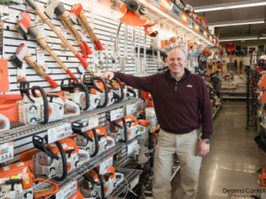 Mike Johnson with chainsaws for sale at St. Johns Ace Hardware