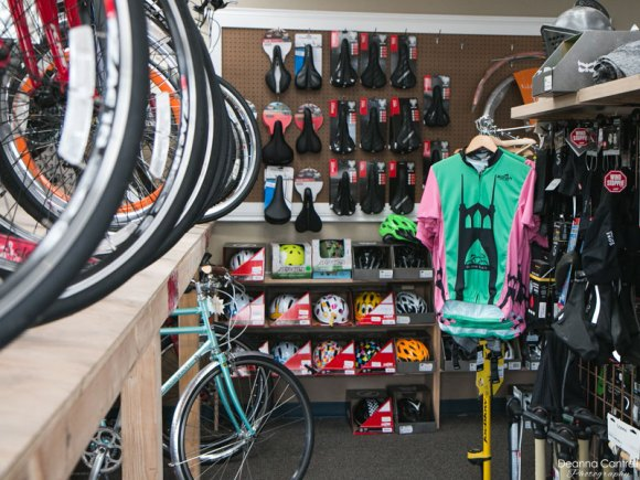 Interior of Block Bikes PDX showing bicycles, bike seats, and bike pumps.