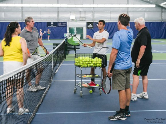An instructor leads a small group lesson at the St. Johns Racquet Center.