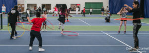 Children with hula hoops at the Racquet Center.