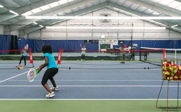 Girl returning a serve at the St. Johns Racquet Center.