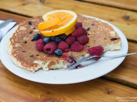 Black current and filbert pancake topped with berries.