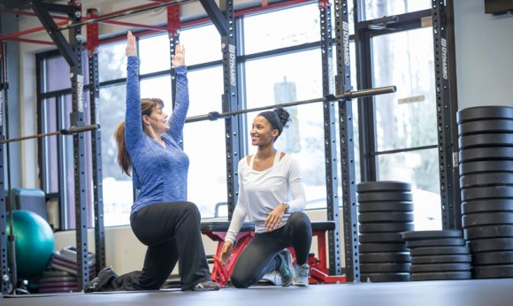 Woman client in cross training class.