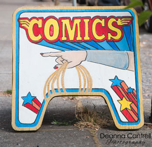 Comics sign in front of Comic Cave PDX