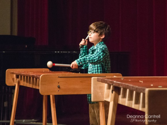 A young student performs on the xylophone at Cathedral Park Performing Arts