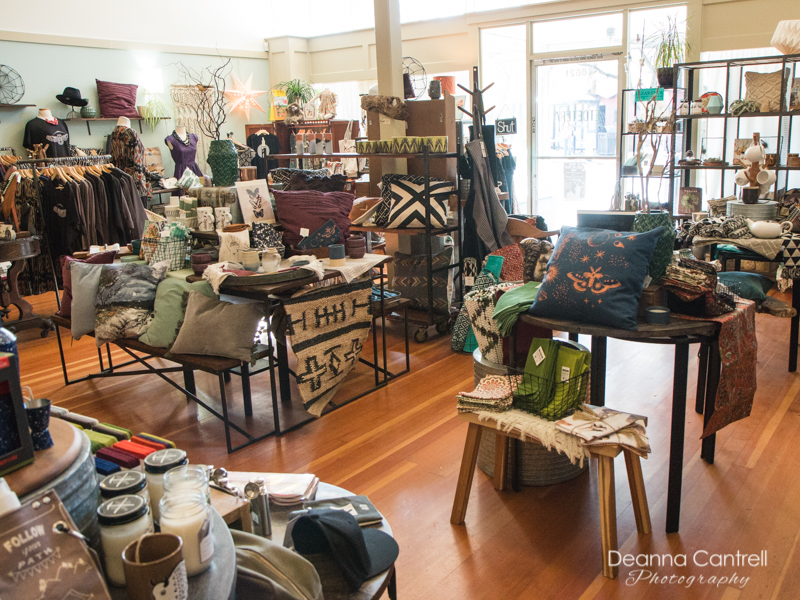 Etcetera Portland interior showing rugs, candles, pillows, clothing and much more.