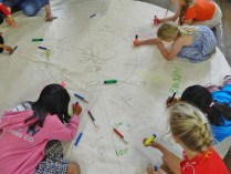 Children writing peace messages for the world