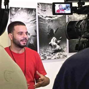 Photographer David Berg is interviewed for Cuban national television.