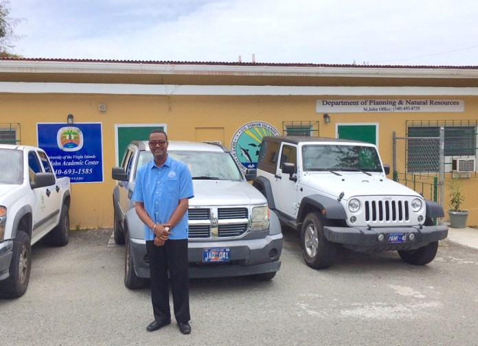 Allen stands in front of the building shared by UVI and DPNR.