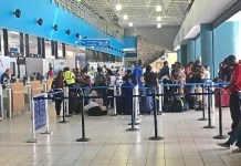 Passengers crowd into the Cyril E. King Airport Thursday to get the first fights out. (V.I. Port Authority photo)