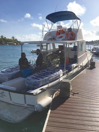 Caribbean Sea Adventures Boston Whaler vessel Recovery brings supplies to St. John Sunday. (Photo provided by Caribbean Sea Adventures)