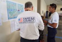 Unidentified members of FEMA search and rescue team members from Virginia making plans while inspecting a map of St. Croix (Photos courtesy of the V.I. National G