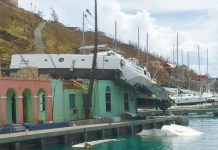 Hurricane Irma's force threw this catamaran on top of a dockside building. (Love City Strong)