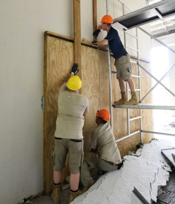 DEMA members make repairs to the St. Croix Educational Complex.