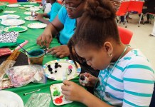 D'enoia Webbe, 7 works on a penguin ornament with her mother Carmen.