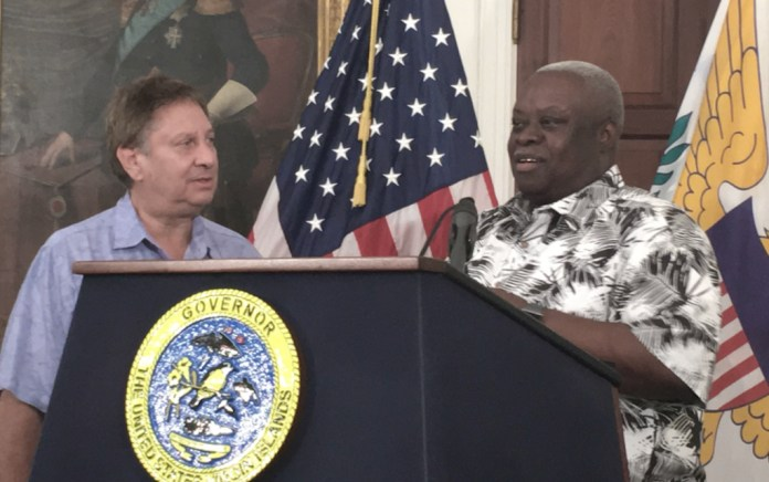 Jonathan Cohen accepts check on behalf of JKC Family from Gov. Kenneth Mapp.