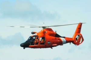 A Coast Guard MH-65 Dolphin helicopter. (File photo by Petty Officer 3rd Class Stephen Lehmann, from Coast Guard archives) .