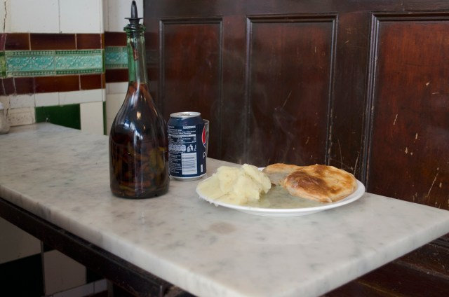 Traditional Pie and Mash with its iconic green parsley liquor at M Manze, Chapel Market, Islington