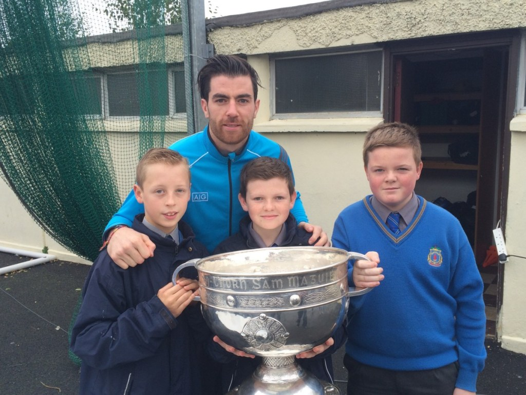 Michale Darragh MacAuley with the Sam Maguire cup and first years Evan White, Oran Burke and Darragh Hendrick