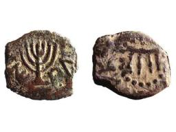 An Ancient Coin with Menorah Engraving