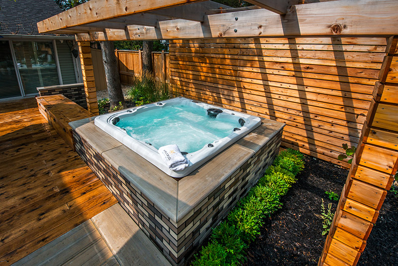 beautiful hot tub with landscaping