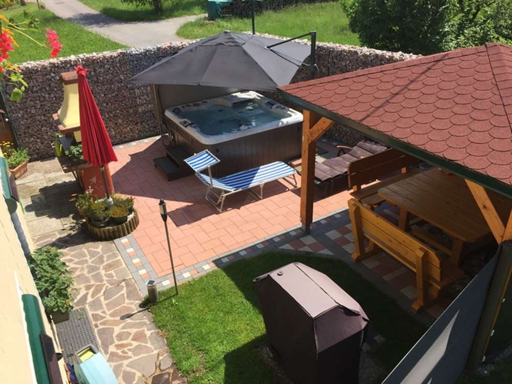 hot tub covered with patio umbrella