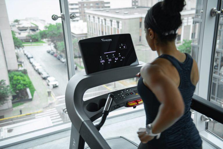 VF19_LIFESTYLE_LC female running console_treadmill_hi-angle back close