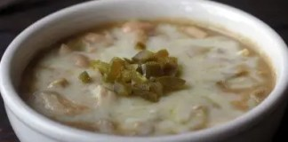 At Lewis and Clark's, the white chili is not terribly spicy and not too thick. They serve it with a small portion of sour cream, jalapeños and crackers on the side.