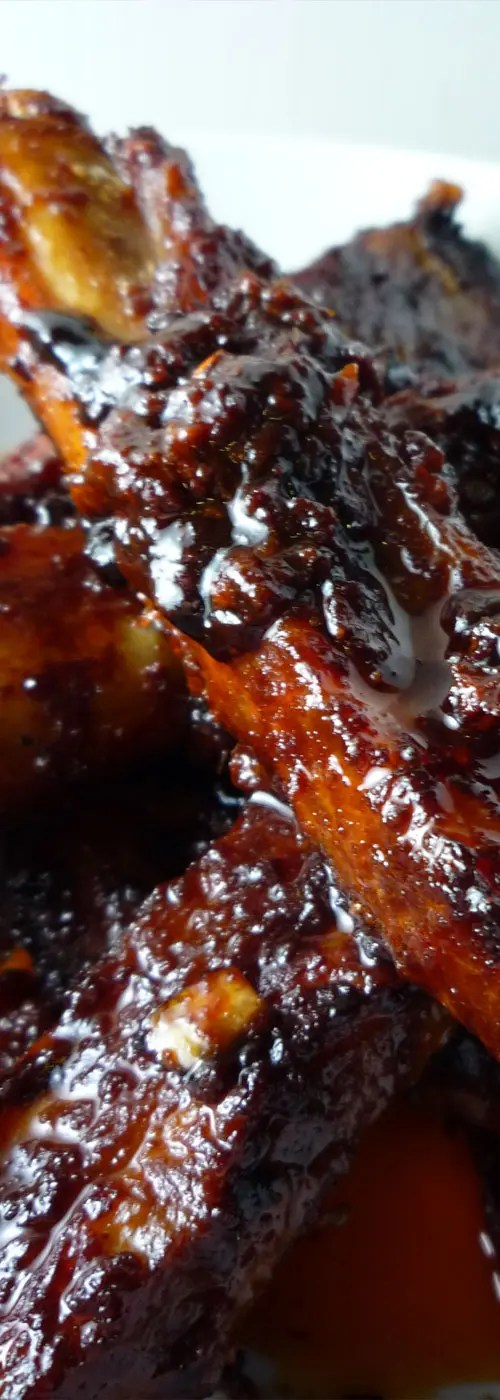 These Spicy Korean Pork Spare Ribs are succulent, sweet, and spicy. They require some advance marinade preparation, but then are easily cooked in the oven. #koreanbbq #bbqrecipe #koreanrecipe