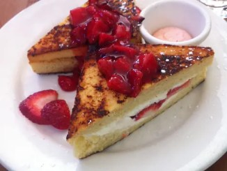 Raspberry mascarpone stuffed French toast is an indulgent breakfast. Layers of bread, mascarpone cheese and tart raspberries are combined in a richly thick and decadent cream.