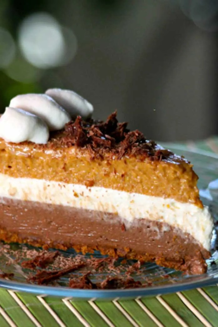 Delightful layers of pumpkin, cheesecake and chocolate, nestled in a Biscoff cookie crust, make a rich and dreamy dessert. This Chocolate Pumpkin Mousse Pie is perfect for your holiday baking! #holiday #baking #dessert #pie #pumpkin #chocolate