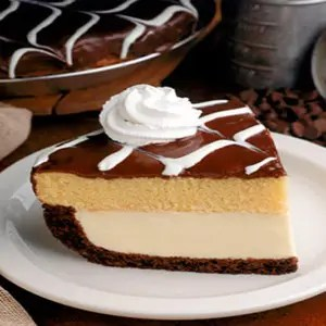 Boston Cream Pie Poke Cake - Major crowd-pleasing cake filled with vanilla  pudding and