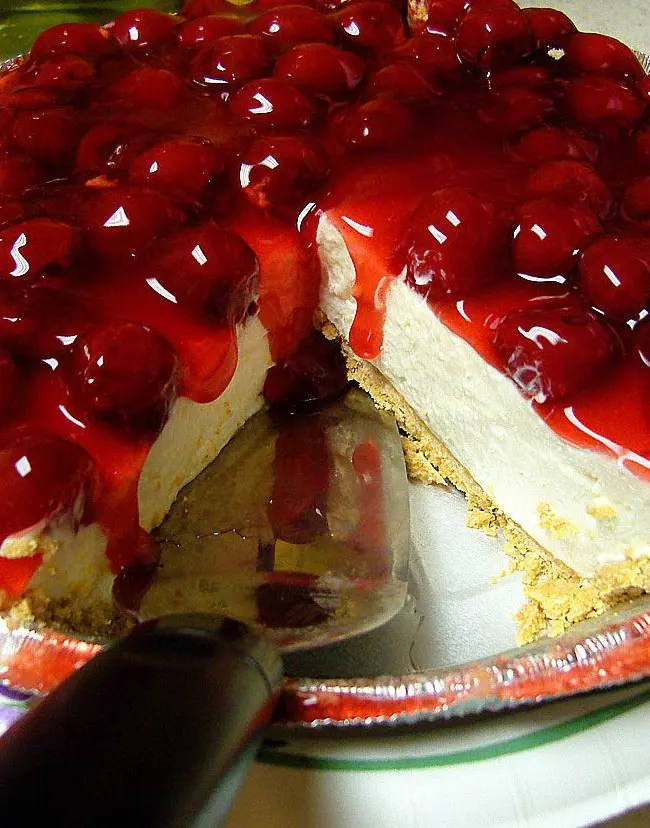 This Cherry-Berry Low Fat Fake Cheesecake is a delectable dessert - vanilla cheesecake with cracker crust base, mouth-watering cherry-berry topping and pure delight in every bite!