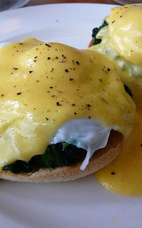 Eggs Florentine Recipe - This variation on the classic eggs Benedict uses spinach instead of Canadian bacon. The hollandaise sauce is prepared over a double boiler, ensuring it cooks slowly and gently.