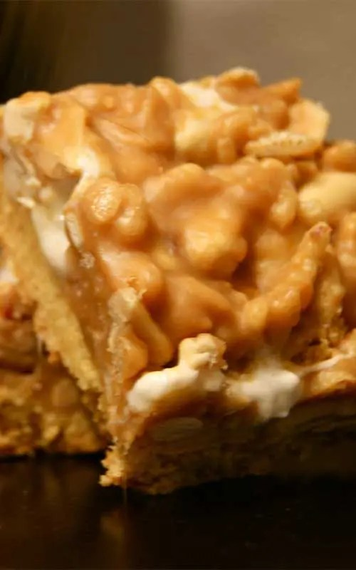 Payday Cookie Bars Recipe - These bars will satisfy any Payday craving. A buttery crust is topped with a sticky mixture of marshmallows, peanuts and rice crispies for crunch.