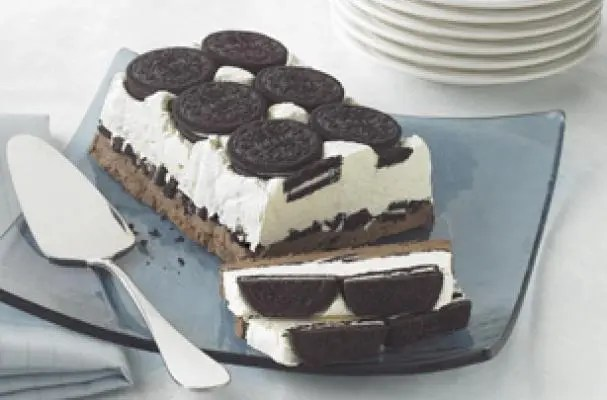 Here's the adult version of milk and cookies, a Cookies and Cream Cake. A big yummyOreoCookie treat with a creamy filling that's frozen, just so it can melt the hearts of dessert lovers everywhere.