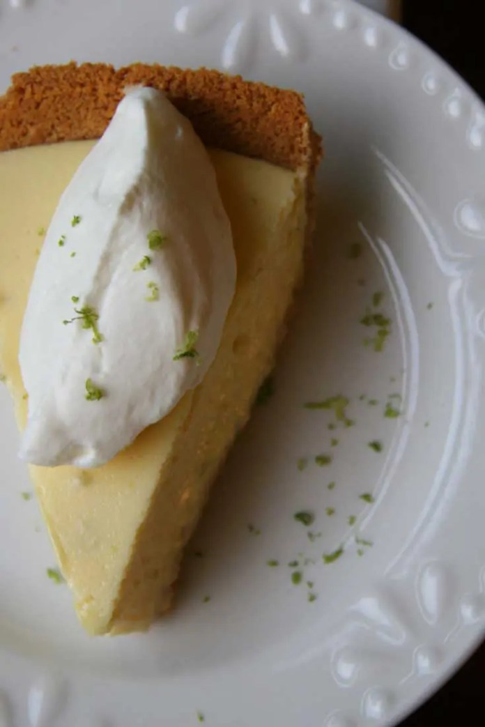 This Key Lime Pie is tart and citrusy. The whipped cream adds just the right amount of sweetness and the graham cracker crust lends the perfect crunch. #lime #pie #dessert #baking