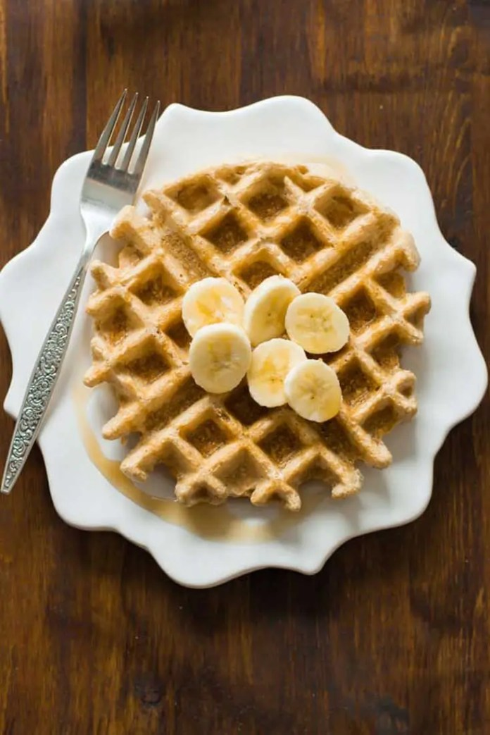 This healthy and delicious Peanut Butter Waffles recipe is made with a few simple ingredients and comes out perfect every time. Enjoy! #breakfast #waffles #peanutbutter