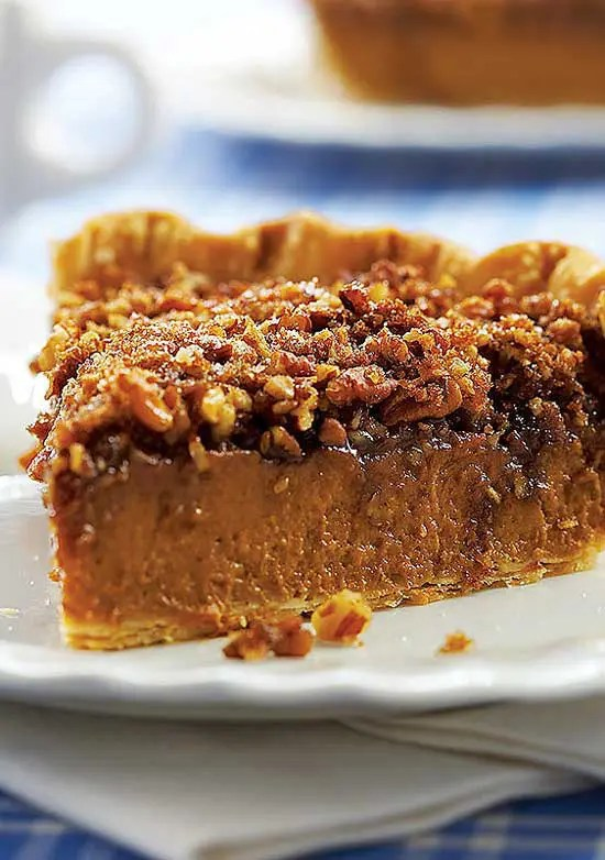 This Praline Pumpkin Pie is a great choice when you can't decide whether to make pumpkin or pecan pie! I adore this pie. I think the praline layer adds a lovely new dimension to a plain ole pumpkin pie.