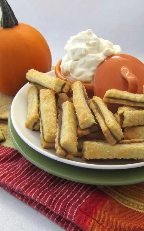 ThesePumpkin Pie Fries are a very fun way to make eating pie with your hands a mess-free experience! These are great for parties, holidays and for kids. I mean seriously. Look at how cute they are