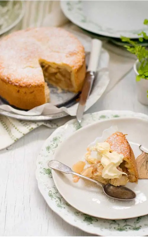 I love baking and thought about an apple pie or an apple crumble but decided to share with you one of my all time favorite apple cake recipes. This Country Apple Cake is a cross between a cake and a pie. It's simple to make and best of all, delicious!