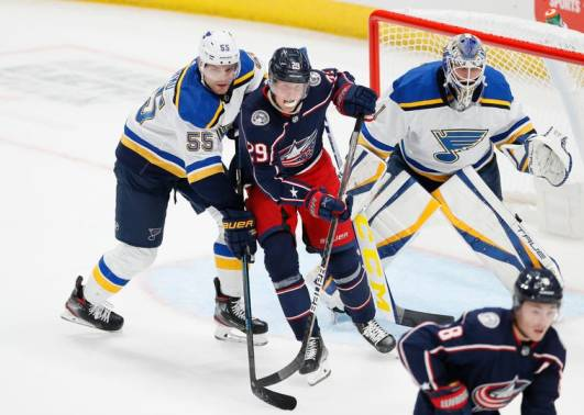 Columbus Blue Jackets right wing Patrik Laine (29) posts up in front of St. Louis Blues defenseman Colton Parayko (55) and goaltender Joel Hofer (1) during the first period of the NHL preseason hockey game at Nationwide Arena in Columbus on Wednesday, Sept. 29, 2021. Adam Cairns/Columbus Dispatch